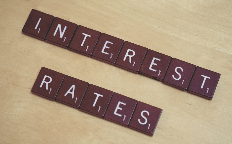 Scrabble pieces spelling out interest rates
