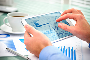 businessman_holding_ipad_with_charts_300px
