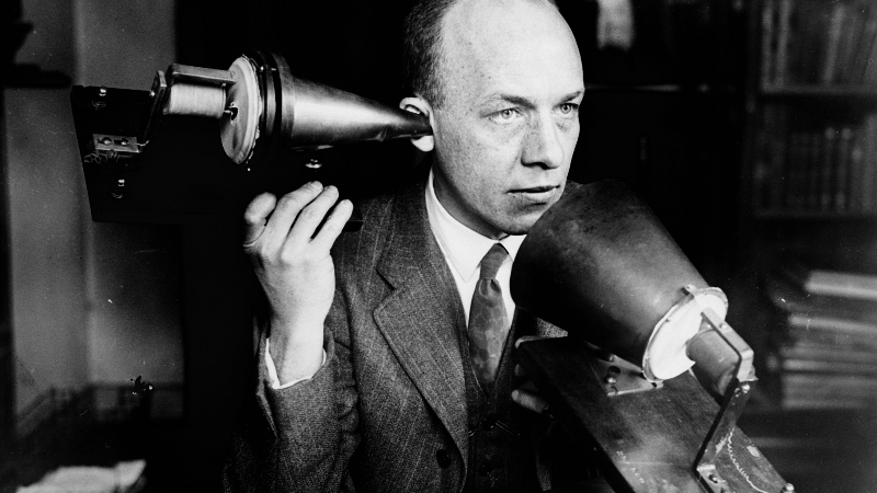 Bell using the first telephone