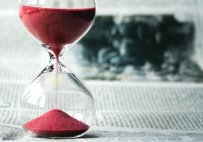 hourglass-on-newspaper