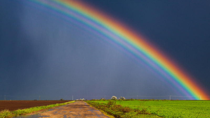 rainbow_dark_clouds_over_country_road