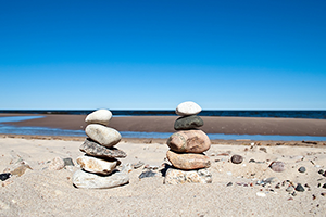 stones-stacked-on-beach-300px
