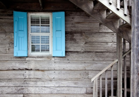 blue shutters wooden house
