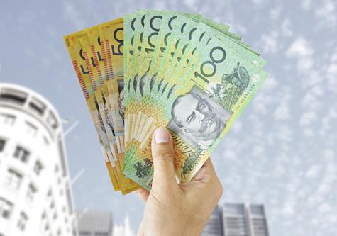 businessman_holding_out_cash