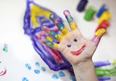 Child hand finger painting