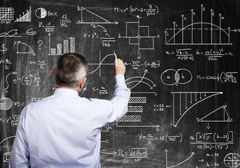 man_drawing_charts_on_blackboard