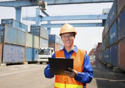 smiling_working_man_at_shipping_yard